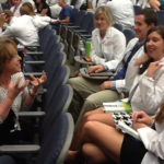 Vida Vaughn, Kornhauser clinical librarian, interacts with dental students during a seminar break.
