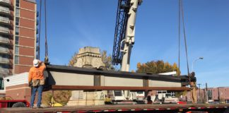 Workers loaded a large section of the confederate monument on a truck during deconstruction of the monument Sunday, nov. 20. The monument will be reassembled in Brandenburg, where it will join other monuments in a historical display.