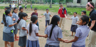 ISLP participants work with students during a previous ISLP trip.